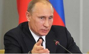 شاهد.. الرئيس الروسى تحت المطر دون مظلته فى تكريم الجندى المجهول